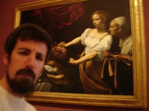 """Me posing with """"Judith beheading Holofernes"""" by Caravaggio 